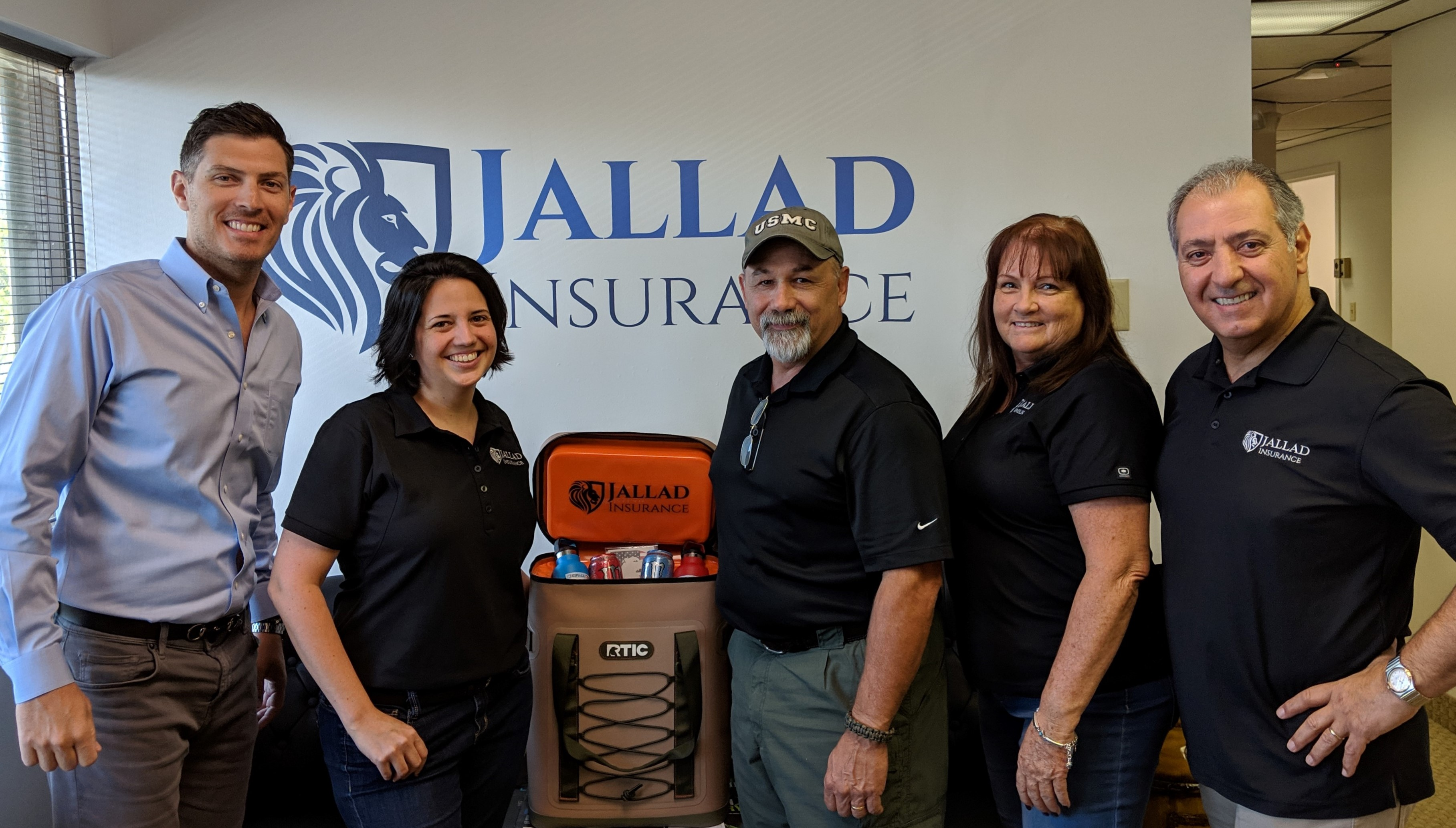 Jallad Insurance Team members & Paul from Iron Pigs with donation.